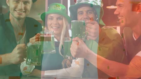 st patrick : Digital composite of young diverse people holding a green beer and toasting for the St Patricks Day with Irish flag waving on the background and confetti falling down on the foreground