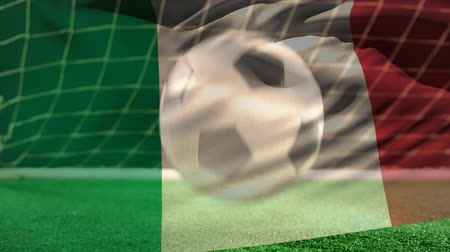 italiaanse vlag : Digital composite of football bouncing on the floor in front of the goal with an Italian flag waving on the foreground Stockvideo