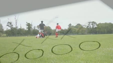 assobio : Digital composite of multi-ethnics rugby players training on field with the coachs strategic paper and whistle on the foreground Stock Footage