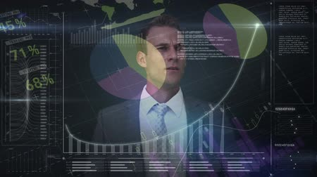 sofisticado : Digital composite of young handsome Caucasian businessman drawing digital graph with data moving on the dark background
