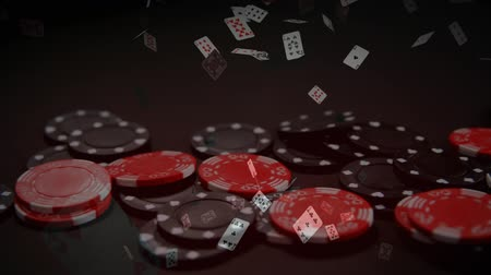 croupier : Digital composite of chips falling down on table while animated game cards moving downwards against dark background Stock Footage
