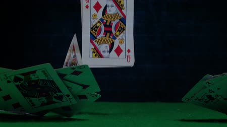 sleeve : Digital composite of game card falling down on green table against dark background