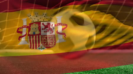 отскок : Digital composite of soccer ball bouncing on grass while Spanish flag waves on the foreground on soccer field.
