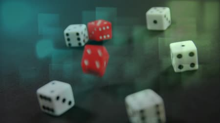 покер : Digital composite of red dice falling down between five white dice on green table with light effects on the foreground Стоковые видеозаписи