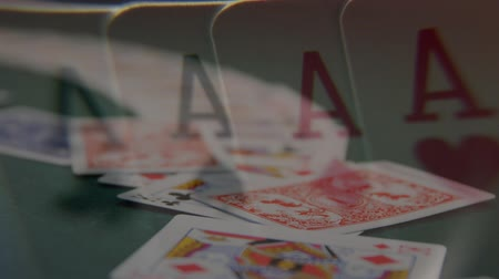 blackjack : Digital composite of game cards thrown on the card table and four aces projected on the foreground