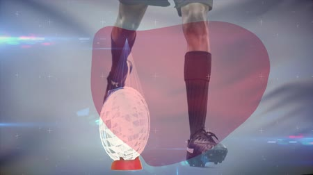 тройник : Lower section of active rugby player kicking the football from tee and animated glass shatters are coming off the football. Japanese flag waves on the foreground.