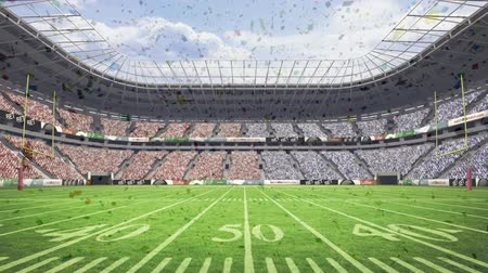 american football player : Digital composite of rugby stadium full of supporters with animated confetti falling down.