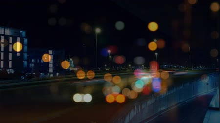 sokak lâmbası direği : Digital composite of cars driving fast on city road with lights effect on the foreground against city background
