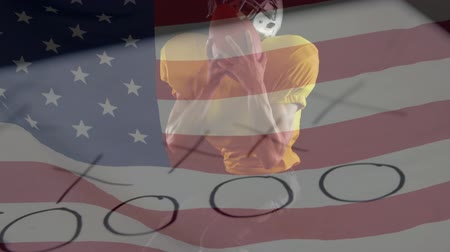 jump away : Digital composite active rugby player catching football while jumping and American flag waving on the background. Strategic paper and whistle projected on the foreground.