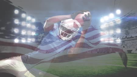 jump away : Digital composite of African American rugby player trying to catch the football and American flag waving on the foreground in full stadium. Rugby player dives to the football with stadium lights on the background.