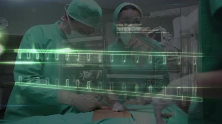 operation theater : Digital composite of group of multi ethnic surgeons operating on patient while DNA is being formed on the foreground
