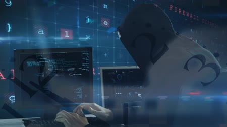 piracy : Digital composite of smart Caucasian hacker with balaclava and black sweater hacking  computer while coding moves on the foreground.