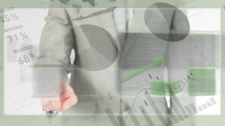 számvitel : Digital composite of businessman swiping on futuristic screen projecting statistical data against paper with statistical data.