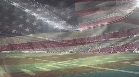 pontão : Digital composite of football stadium full of supporters and American flag waving on the foreground.