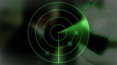 радар : Digital composite of green coloured radar detecting airplanes against rotating globe and shadow of people working in the background