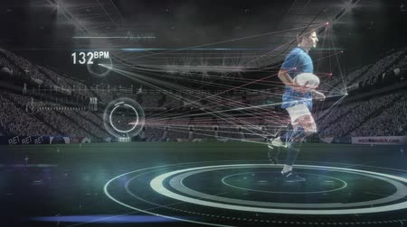 оценка : Digital composite of rugby player running with football in slow motion while interface measures players conditions in stadium. Стоковые видеозаписи