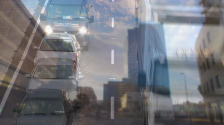 kavrama : Digital composite of cars driving fast on city road with city on the background