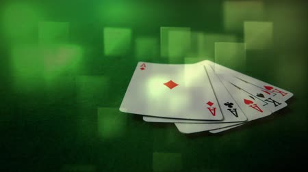 kombinasyon : Digital composite of five cards falling on the ground against a green background. Light green colored cubes move on the foreground Stok Video