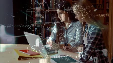 Side view animation of two Caucasian students working on a laptop in a library against mathematical calculations in background