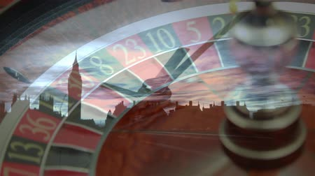 ruleta : Digital composite of roulette scrolling with clock rotating on a cityscape background