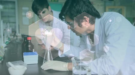 medical student : Digital composite of scientist conducting experiments against an animation of hexagon shape