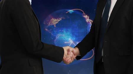 sofisticado : Digital composite of businessmen closing a deal against spinning numeric globe and light effects on blue background Stock Footage