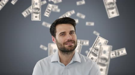 cash free : Digital composite of happy Caucasian businessman with money in free-fall on grey background. He is looking and smiling at camera
