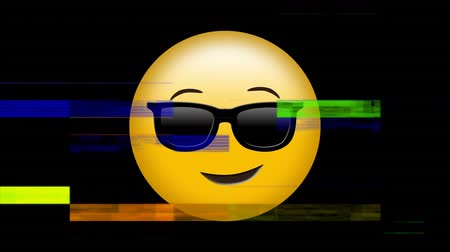 редактируемые : Digitally animated of yellow emoji with black glasses with colorful scrambled on black background. He seems to be pretentious. Стоковые видеозаписи