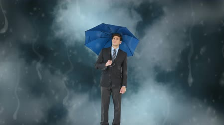 sofisticado : Digital composite of the Caucasian businessman standing with his umbrella under the animation of the storm