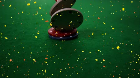 ruletka : Digital composite of token and dice falling on poker table with confetti animation
