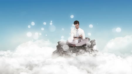 görgetés : Digital animation of thougtful man using digital tablet on rock. Sitting on cloud with sun. bubble animation