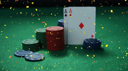 como : Digital composite of tokens and cards posed on casino table with confetti animation Stock Footage