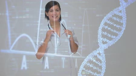 geny : Digital composition of a DNA molecule rotating and data charts scrolling on a black screen with a female doctor smiling to the camera on the foreground Wideo