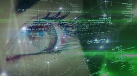 сети : Digital composite of a female eye. Foreground with green light and asymmetrical lines and digital information. Стоковые видеозаписи