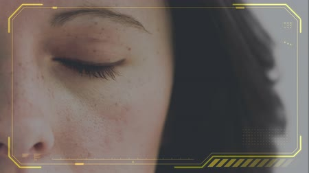 ультра : Digital composite of a Caucasian woman right eye, slowly opening while yellow glowing frames the screen.