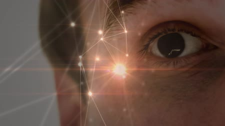 удивительный : Digital composite of an adult Caucasian male right eye, opening and surprised by glowing lights while foreground shows glowing white asymmetrical lights.