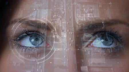 concentrando : Digital composite of an adult Caucasian female eyes looking around the screen and then focusing at the middle against a background of birds eye view of road and highway with cars.