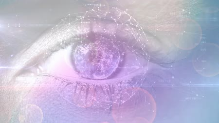 鮮やか : Digital composite of an adult female eye while focusing on asymmetrical lines forming a sphere and circular bokeh lights. 動画素材