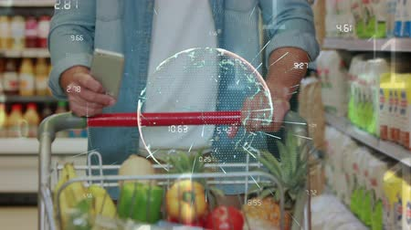 ícone : Digital composite of an adult man pushing cart at the grocery and checking his phone. Digital numbers and a sphere at the middle of the screen shows during the video Stock Footage