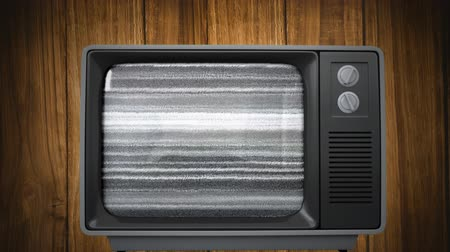 sintonizador : Digitally generated old television showing a video of the rainbow set against a wooden wall