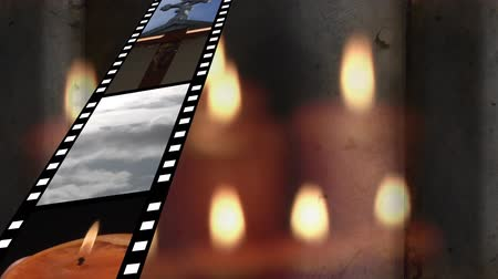witness : Digitally generated film strip showing different videos. Background shows lighted candles. Stock Footage
