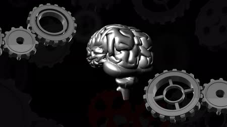 stowarzyszenie : Digitally generated gears moving while human brain rotates at the center. Black background Wideo