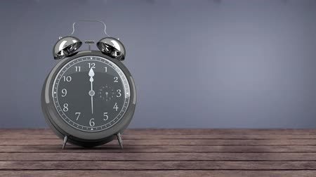 encanecido : Digitally generated alarm clock striking to 12 and rings. Wooden floor and grayish blue background