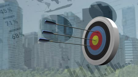 tiro com arco : Digitally generated archery target. Background of the city while graphs and charts moves Stock Footage