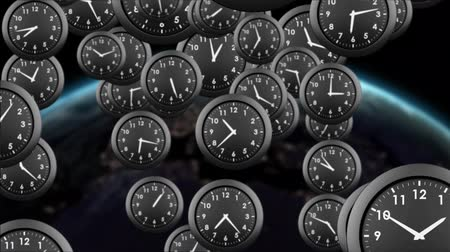 planeta : Digitally generated black clocks falling. Background shows the surface of the earth. Stock Footage
