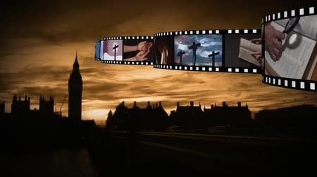 jehovah witness : Digital composite of Silhouette of town or city while film strips moves on top with different photographs and videos about religion