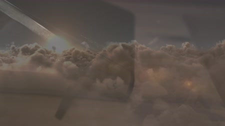 crucifix : Digital composite of a bible opening with crucifix inside. Background shows the sky with the clouds and sun