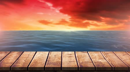 acalmar : Digital composite of a calm sea during the sunset. Wooden plank a the bottom of the screen.