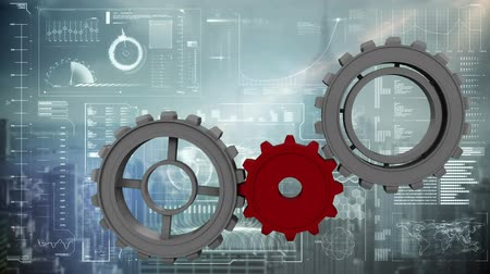 graph : Digitally generated gray gears being completed by a red gear. Background shows different digital information and cityscape. Stock Footage