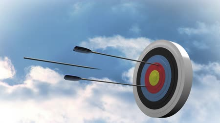 tiro com arco : Digitally generated target being shot by arrows with the sky with clouds as background Stock Footage
